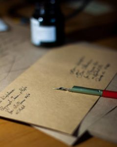 photo of an envelope being hand written