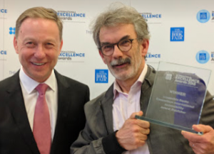 Luc Audrain receiving the ABC International Excellence Award