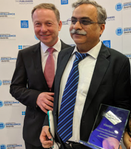 Dipendra manocha receiving the ABC International Excellence Award
