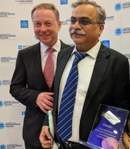 Dipendra manocha receiving the ABC International Excellence Award