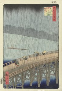 A woodcut print by Utagawa Hiroshige depicts figures scattering during a sudden rainstorm on the Shin-Ōhashi bridge in Edo (now Tokyo) in 1857.