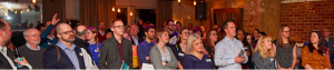 Delegates avidly watching the presentations