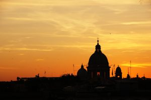 Glorious sunset in Rome with the silhouette of St Peter's Basilica dominating the skyline
