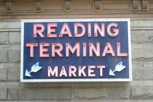 "A sign stating ""Reading Terminal market"""