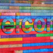 "Rainbow coloured block with the word ""Welcome"" embossed"