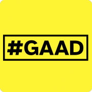 A yellow sign with #GAAD written in black